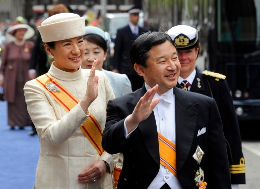 Japan's Crown Prince Naruhito and Crown Princess Masako wave as they arrive at the Nieuwe Kerk or New Church in Amsterdam, The Netherlands, for the inauguration of King Willem-Alexander Tuesday April 30, 2013. Around a million people are expected to descend on the Dutch capital for a huge street party to celebrate the first new Dutch monarch in 33 years. (AP Photo/Toussaint Kluiters, Pool)